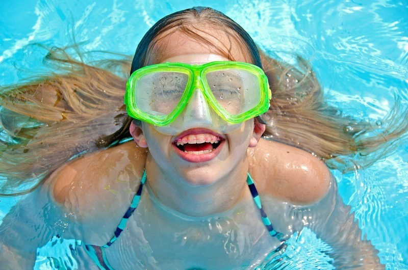 Girl Wearing plastic aligners while swimming