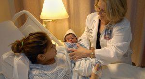 Midwifery Nurse Taking care of the newborn baby