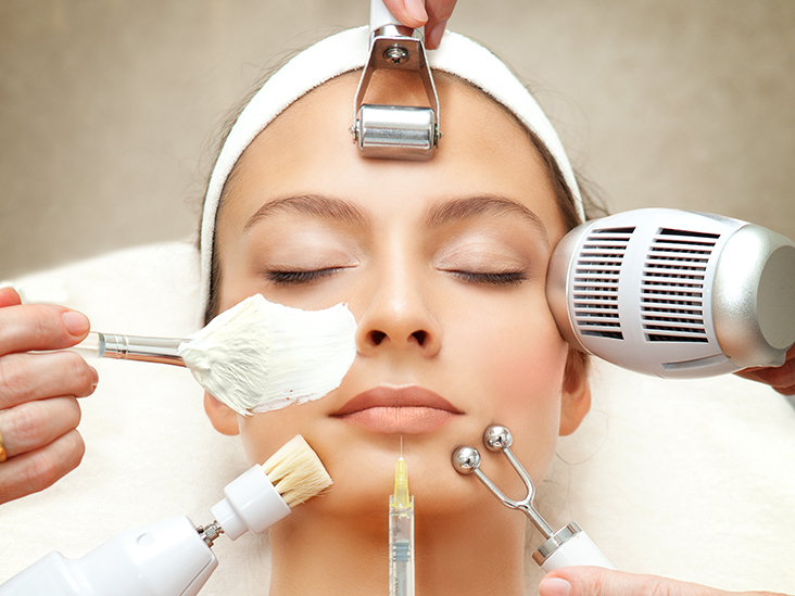 Spa Salon: Young Beautiful Woman Having Different Facial Treatment.